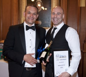 Simon Cooper of All Dry Damp Proofing Ltd Collecting their prize of best website at the PCA good practise awards