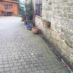 Outside rainwater runs towards the property