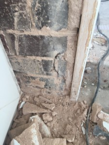 Browning touching the masonry and floor in between the door casing (Barnsley)