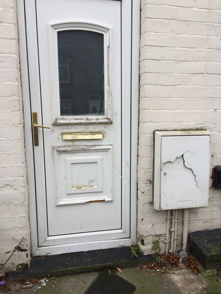 The damaged front Door